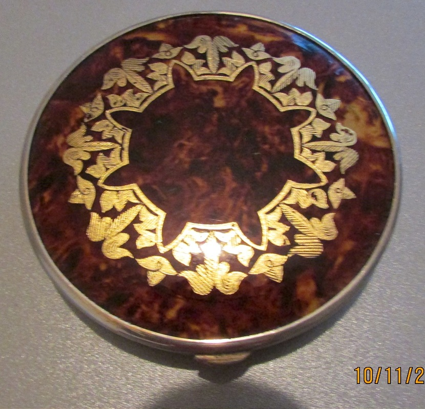 Brown faux tortoiseshell and gold compact