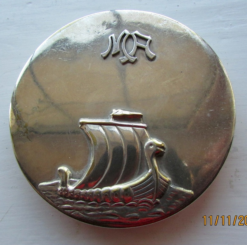 Silver-coloured compact with Danish Viking ship