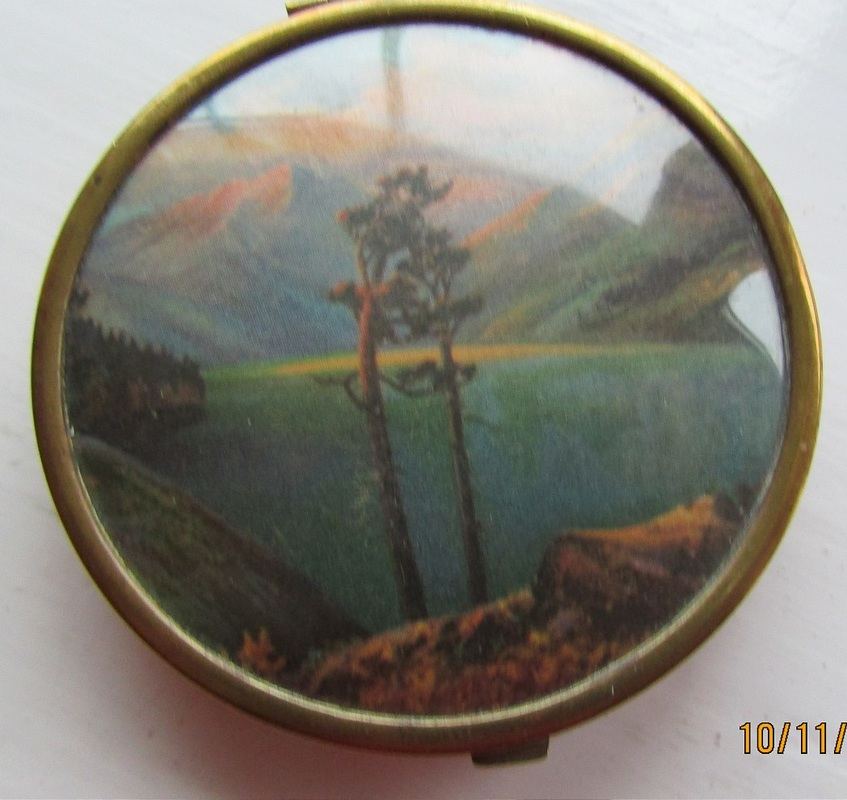 Small compact with lake and mountain scene